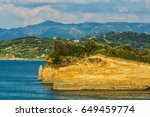 Small photo of Beautiful view on Corfu island sand seamy rocks at the Ionian blue sea.