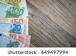 european money isolated on wood ...   Shutterstock . vector #649497994