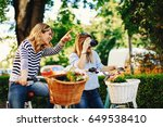 two young women tourists... | Shutterstock . vector #649538410