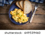 scrambled eggs with onion and... | Shutterstock . vector #649539460
