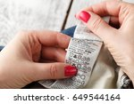 woman checking the care label... | Shutterstock . vector #649544164