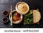 peking duck in bamboo steamer... | Shutterstock . vector #649562200