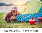 tourist to erect a tent near... | Shutterstock . vector #649571488