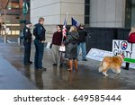 Small photo of PORTLAND, OREGON MARCH 06 2017, David Fry, acquitted defendant in the first trial of the occupation of the Malheur Wildlife Refuge and others protesting the second trial walking holding American flags