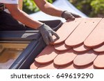 hands of roofer laying tile on... | Shutterstock . vector #649619290