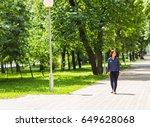 beautiful young woman walking... | Shutterstock . vector #649628068