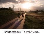 couple riding bicycles on... | Shutterstock . vector #649649203