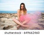 beautiful young girl with smoke ... | Shutterstock . vector #649662460
