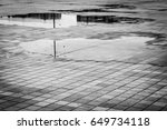 a lot of puddles on the brick... | Shutterstock . vector #649734118