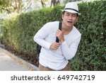 unhappy painful man carrying... | Shutterstock . vector #649742719