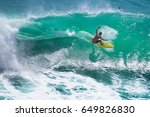 surfer riding big wave at... | Shutterstock . vector #649826830