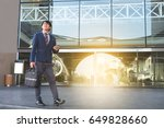 businessman walking on the... | Shutterstock . vector #649828660