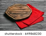 empty wooden board and napkin... | Shutterstock . vector #649868230