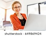 young woman in office | Shutterstock . vector #649869424