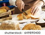 female hands cutting freshly... | Shutterstock . vector #649890400