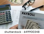 Small photo of PAYROLL Businessman working Financial accounting concept