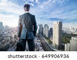 Businessman Looking Down A...