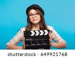 smiling young woman holding a... | Shutterstock . vector #649921768