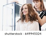 closeup hairdresser makes... | Shutterstock . vector #649945324