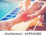 swimmer suffering from leg... | Shutterstock . vector #649946380