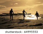 Kite surfer at sunset - stock photo