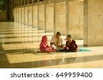 muslim father teaching quran...   Shutterstock . vector #649959400
