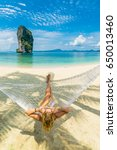 woman relaxing at the beach on... | Shutterstock . vector #650013460