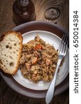 Small photo of Traditional polish sauerkraut (bigos) with mushrooms and meat. Shallow depth of field.