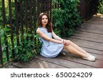 girl pose to camera at park...   Shutterstock . vector #650024209