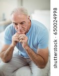 tense senior man sitting on bed ...   Shutterstock . vector #650024998