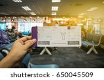 boarding pass on hand with blur ... | Shutterstock . vector #650045509