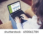 woman consulting web statistics ... | Shutterstock . vector #650061784