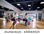 group training. girls do squats ... | Shutterstock . vector #650064424