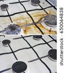 Small photo of Dirty and clean gas cooker with burners close up, before and after