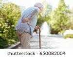 retired ill woman feeling... | Shutterstock . vector #650082004