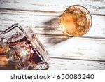 whiskey bottle and whiskey... | Shutterstock . vector #650083240