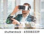 architect in vr glasses working ... | Shutterstock . vector #650083339