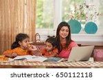 cheerful pretty indian woman... | Shutterstock . vector #650112118