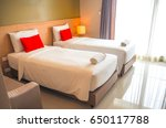 Twin Bed With Red Pillow In A...