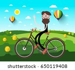 man on bicycle on field with... | Shutterstock .eps vector #650119408