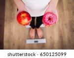 diet. woman measuring body... | Shutterstock . vector #650125099