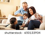 happy family sitting on sofa in ... | Shutterstock . vector #650133934