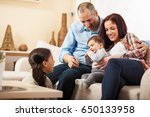 happy family sitting on sofa in ... | Shutterstock . vector #650133958