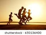 group of young people runs at... | Shutterstock . vector #650136400
