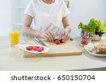 girl is preparing breakfast | Shutterstock . vector #650150704
