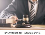 judge holding a gavel with... | Shutterstock . vector #650181448