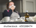sick woman sneezing to tissue.... | Shutterstock . vector #650188474