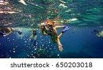 young girl snorkeling | Shutterstock . vector #650203018
