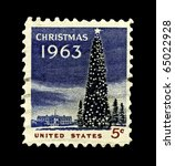 USA - CIRCA 1963-  America's Christmas postage stamp shows the White House and the National Christmas Tree in Washington DC., circa 1963. - stock photo