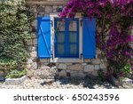 window with blue shutters and... | Shutterstock . vector #650243596
